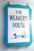 Ellie's weaving shop's sign now hangs in the couples Westboro home.