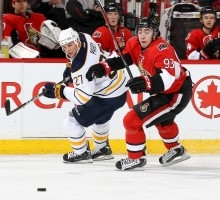 Zibanejad Is A Star Ready To Explode– image 2.jpeg Zibanejad battles for a loose puck against the Buffalo Sabres' Adam Pardy. Photo credit: Getty Images