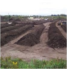 Organic material is delivered to a composting facility and mixed with seed. It is then spread across tunnels that heat up the material to enhance the natural decay process. PHOTO: COURTESY PLASCO ENERGY GROUP