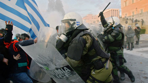 Greek riot police confront rioters in Athens