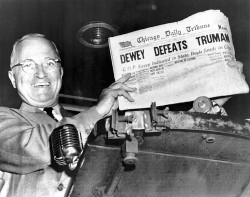 The day after the 1948 election President Truman holds the Chicago Tribune with its faulty prediction