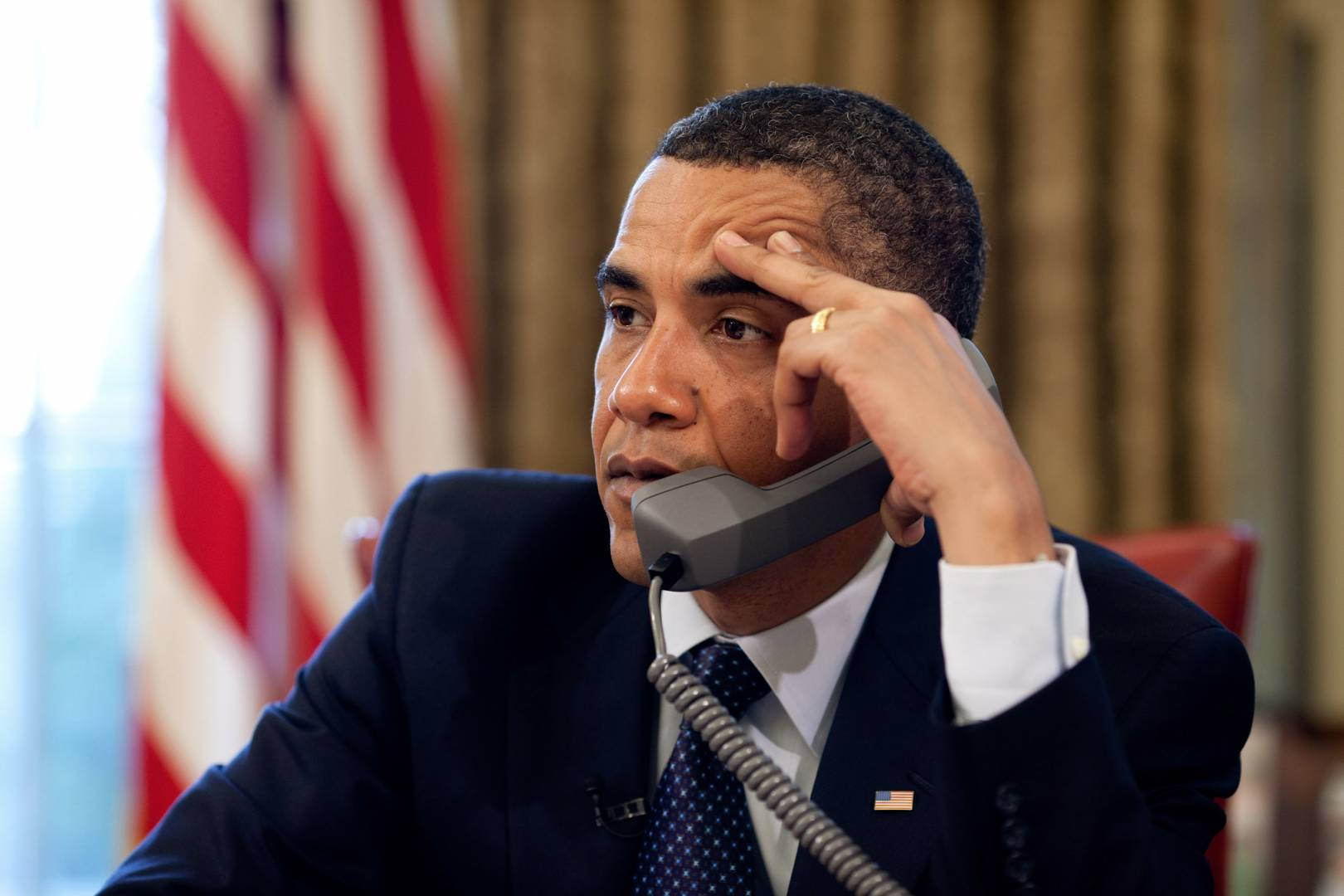 US President Barack Obama receiving bad news in the Oval Office