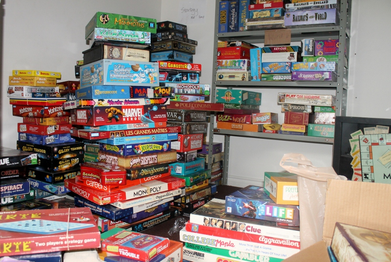 Board games lay stacked to the ceiling, waiting to be lined up for the opening of Monopolatte