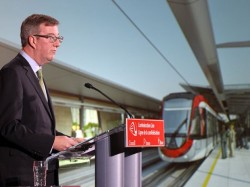 Ottawa Mayor Jim Watson unveils artists' renderings of the Confederation Line that will run under Queen Street.