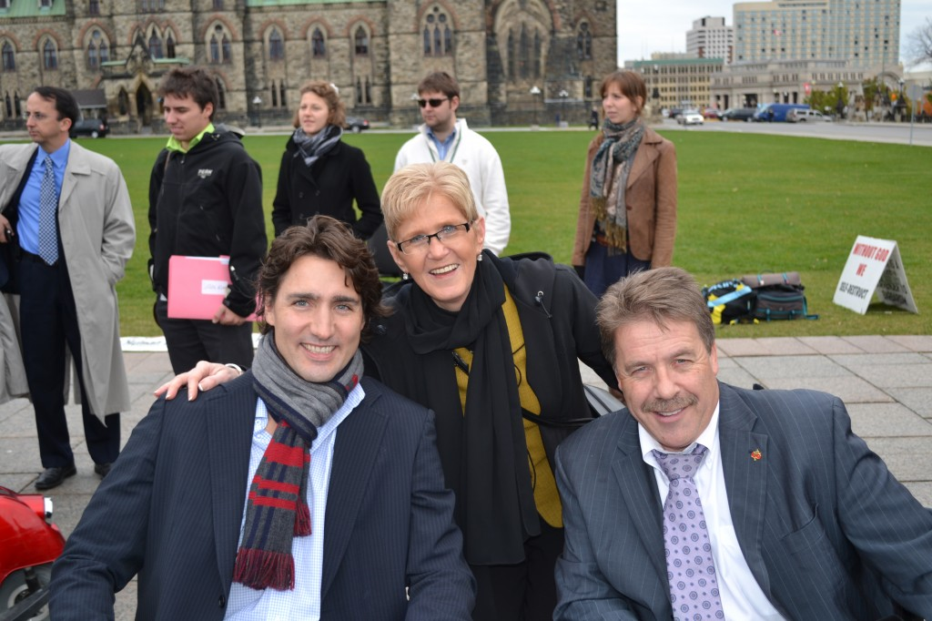 Myrtle Jenkins-Smith, President of Spinal Cord Injury Canada, with Justin Trudeau and Peter Stoffer