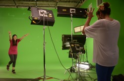 Barrhaven singer Ayda Khan, who is singing a Radical Tune (on green screen).