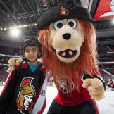 Ottawa Senators mascot Spartacat and a child from one of the Sens Foundation's Learn to Skate Days.