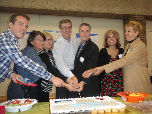 Ottawa Councillor Mathieu Fleury, TRY Program participant Cheryl, President and CEO of the YMCA-YWCA of the National Capital Region Deirdre Speers, Ottawa Mayor Jim Watson, Councillor Mark Taylor, Councillor Katherine Hobbs and Janice Burelle, Administrator with the City of Ottawa's Housing Services, cut the cake during a celebration at the Taggart Family YMCA-YWCA on Friday, Sept. 13. 2013. The City joined together with the Y to celebrate the successes of the TRY Supportive Housing Program for Women.