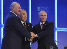 Russian President Putin, Kazakh President Nazarbayev and Belarus President Lukashenko shake hands during a meeting of the Eurasian Economic Union in Astana