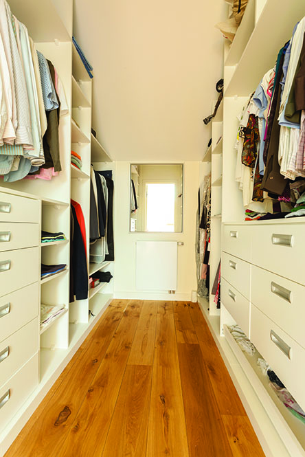 View of bright spacious closet in modern house