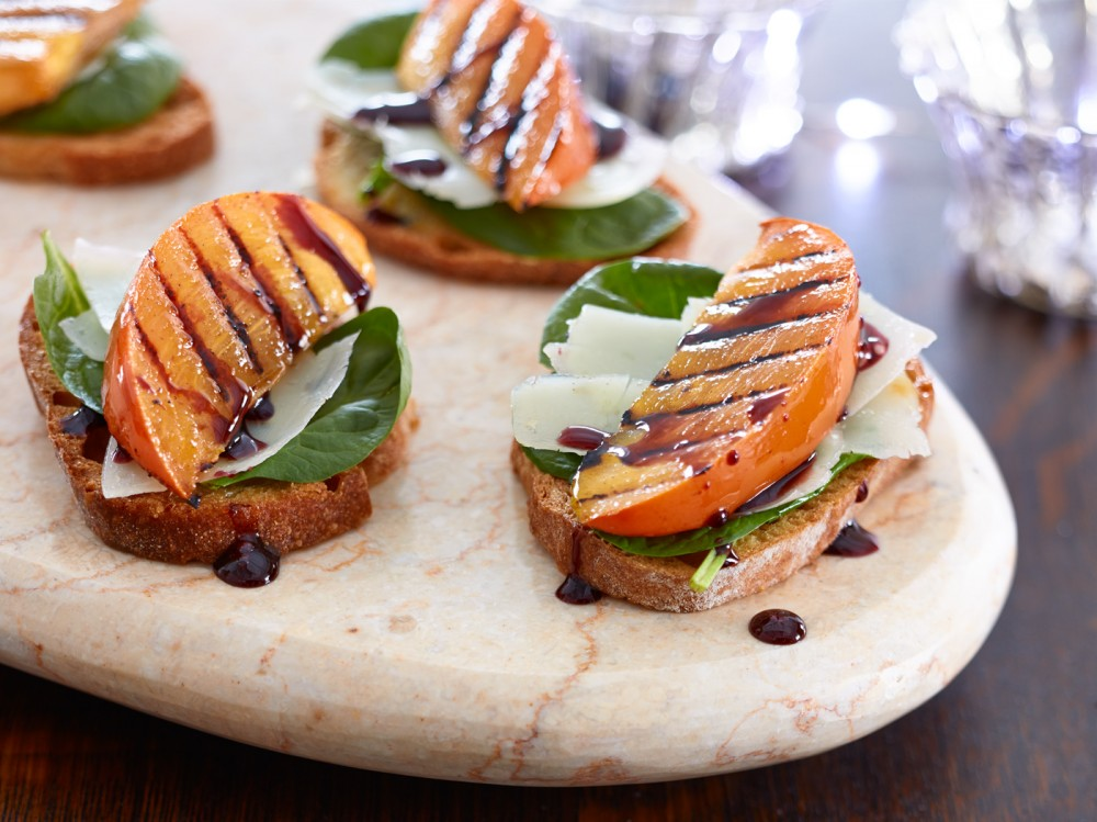 Grilled Persimon Crostini with Manchego and Wine Reduction