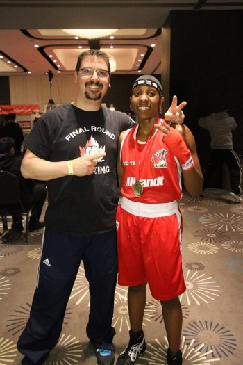 Erica Adjei and Eric Belanger, owner of Final Round Boxing shows off the gold medal she received after her final match in Quebec City.