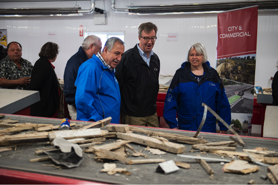 Ottawa Mayor Jim Watson, centre, takes a tour of Tomlinson's new waste recovery centre in Carp at the community opening event on June 11. He is joined by Councillors Eli El-Chantiry and Marianne Wilkinson.